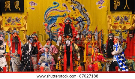 "BEIJING - NOVEMBER 16: Unidentified actors of the Beijing Opera Troupe perform the famous story ""Journey to the West"" at the Huguang Theater on November 16, 2010, in Beijing, China. - stock photo"