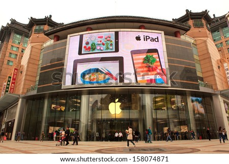 BEIJING-OCT 12: Apple store in Wangfujing shopping area on Oct.12, 2013 in Beijing, China. Apple Inc. says its iPhone 5s and 5c will be available in 52 countries by next month. - stock photo