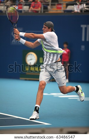 BEIJING - OCT 8: John Isner of USA during his match against Nikolay Davydenko of Russia at the 2010 China Open on Oct 8, 2010 in Beijing, China.