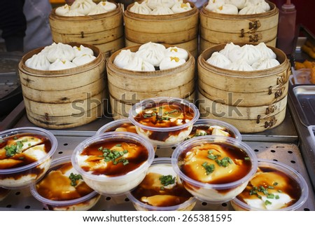 BEIJING - OCT 15: Street view of Dazhalan Market, food stall present, on Oct 15, 2014, Beijing, China. This is famous business street outside Qianmen, one of the largest traditional market in Beijing  - stock photo
