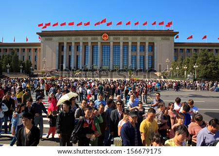 BEIJING-OCT 2: Visitors crowd Tiananmen area  on Oct 2, 2013 in Beijing, China. The National Day on October 1st marked the 64st anniversary of the founding of the People's Republic of China. - stock photo