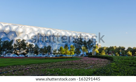BEIJING - OCTOBER 13. Beijing Water Cube at sunset on Oct 13, 2013. It hosted Olympic swimming and diving events. Its capacity was 17000m2 and is reduced to 6000 after the Olympics.  - stock photo