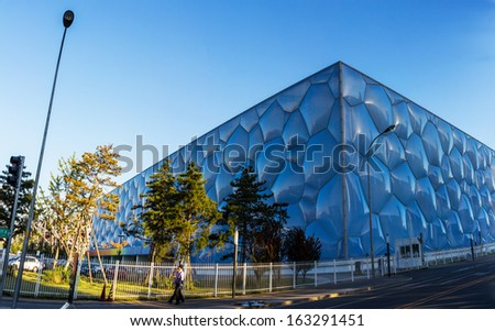 BEIJING - OCTOBER 13. Beijing Water Cube at sunset on Oct 13, 2013. It hosted Olympic swimming and diving events. Its capacity was 17.000m2 and is reduced to 6.000 after the Olympics.  - stock photo