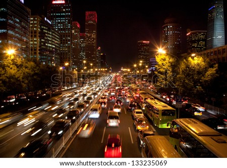 BEIJING-OCTOBER 25: Traffic jam on  Oct 25, 2010 in Beijing, China. The Beijing municipal government has the controlling traffic jams at the top of the to-do list to benefit people in 2013 - stock photo