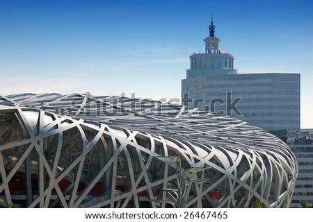 Beijing Olympic Stadium and Modern Building - stock photo
