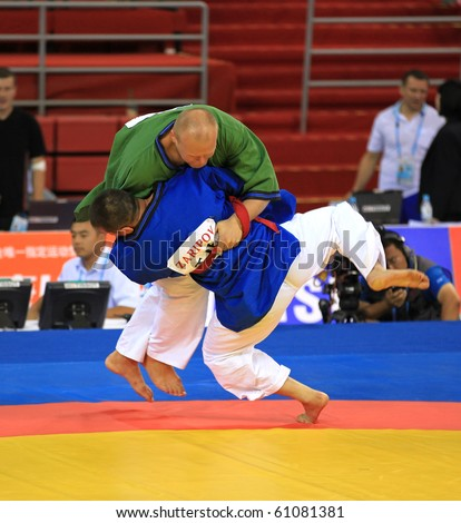 BEIJING-SEP01: A. Sikorski of Belarus (T) fights against S.Zaripov of Tajikistan (B) during the Men's Belt Wrestling competitions of the SportAccord Combat Games 2010 on Sep 01, 2010 in Beijing, China - stock photo
