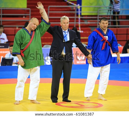 BEIJING-SEP 01:Andrei  Sikorski of Belarus (L) is declared winner of a match during the Men's Belt Wrestling competitions of the SportAccord Combat Games 2010 Beijing on Sep 01,2010 in Beijing, China. - stock photo