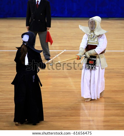BEIJING-SEP 03: Ann Sachiko Tamura of USA(L) fights against Huifang Yang of China(R) during the Kendo competitions of the SportAccord Combat Games 2010 Beijing on Sep 03, 2010 in Beijing, China - stock photo