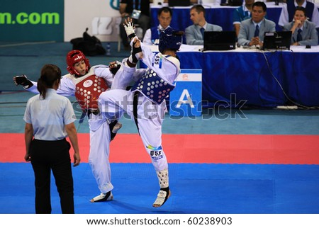BEIJING-SEP 02: Bat-El Gatterer of Israel (L) fights against Pei Hua Tseng of Chinese Taipei (R) during the Taekwondo competitions of the SportAccord Combat Games 2010 on Sep 02, 2010 in Beijing,China - stock photo