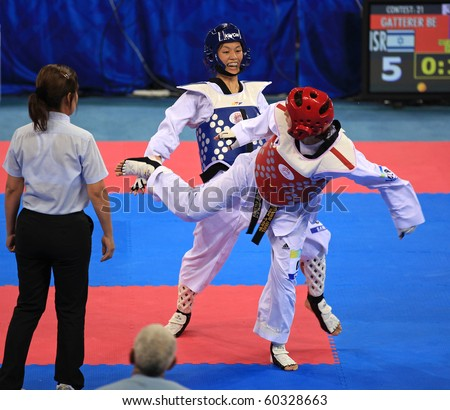 BEIJING-SEP 02:Bat-El Gatterer of Israel(R) fights against Pei Hua Tseng of Chinese Taipei(C) during the Taekwondo competitions of the SportAccord Combat Games 2010 on Sep02,2010 in Beijing, China - stock photo