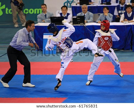 BEIJING-SEP 02: Buttree Puedpong of Thailand(R) fights against Brigida Yague of Spain(L)  during the Karate competitions of the SportAccord Combat Games 2010 Beijing on Sep 02, 2010 in Beijing, China - stock photo