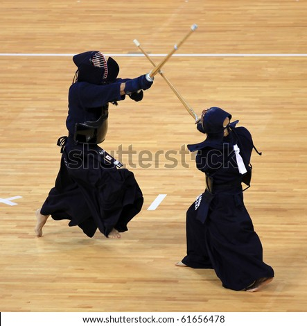 BEIJING-SEP 03: Ernesto Eisaku Onaka of Brazil(R) fights against Shoji Teramoto of Japan(L) during the Kendo competitions of the SportAccord Combat Games 2010 Beijing on Sep 03, 2010 in Beijing, China - stock photo