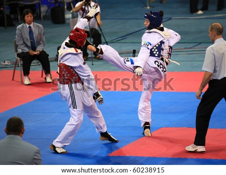 BEIJING-SEP 02:Gwladys Epangue of France(L) fights against Bianca Walkden of Great Britain (R) during the Taekwondo competitions of the SportAccord Combat Games 2010 on Sep 2,2010 in Beijing,China - stock photo