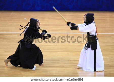 BEIJING-SEP03: K.A. Sylvester of Australia(L) fights against K.H.Jeon of Republic of Korea(R) during the Kendo competitions of the SportAccord Combat Games 2010 Beijing on Sep 03,2010 in Beijing,China - stock photo