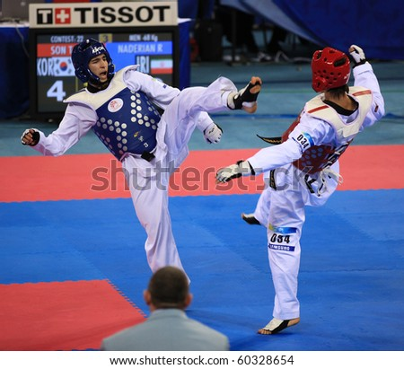 BEIJING-SEP 02: Taejin Son of Korea (R) fights against Reza Naderian of Iran (L) during the Taekwondo competitions of the SportAccord Combat Games 2010 Beijing on Sep 02, 2010 in Beijing, China - stock photo