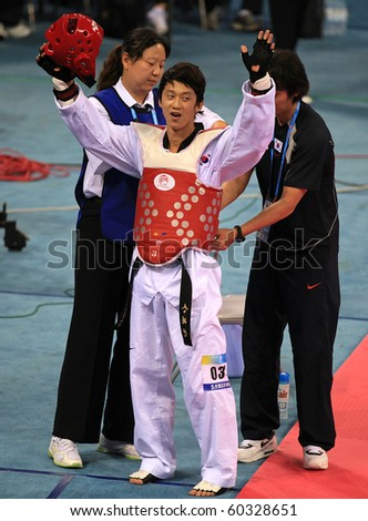 BEIJING-SEP 02: Taejin Son of Korea reacts after winning the -68 kg Men Gold-medal match during the Taekwondo competitions of the SportAccord Combat Games 2010 Beijing on Sep 02,2010 in Beijing, China - stock photo