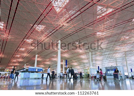 BEIJING-SEPT. 3, 2012. Departure hall Beijing Capital Airport Terminal 3 on Sept. 3, 2012. The airport registered 488,495 aircraft movements (take-offs + landings) and as ranked 10th in the world. - stock photo