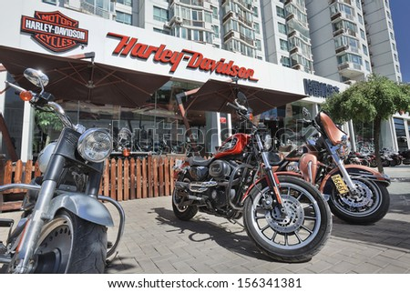 BEIJING-SEPT. 25. Harley Davidson shop. HD began China sales in 2005, its bikes are extremely high taxed: a HD bike might sell for $32,500, about four times average salary. Beijing, Sept. 25, 2013.  - stock photo