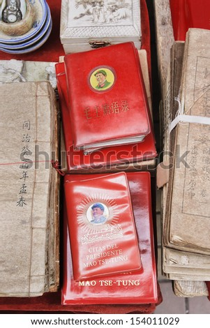 BEIJING-SEPT 8. Little Red Book on flea market. Quotations from Mao Zedong is a book of selected statements from his speeches and writings, published from 1964 to about 1976. Beijing, Sept. 8, 2006.  - stock photo