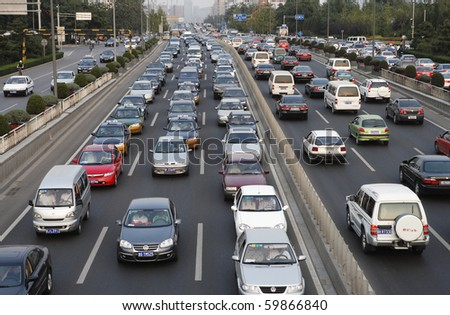 BEIJING - SEPTEMBER 25:  General view of heavy traffic from an overpass  September 25, 2007 in Beijing, China. - stock photo