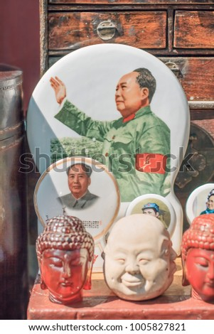 BEIJING-SEPTEMBER 8, 2010. Objects with Mao Zedong images displayed on Panjiayuan market, largest, most complete, cheapest and most popular market selling second hand goods and curios in China.