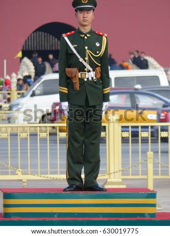 Beijing / Tiananmen Square / picture showing a guard in the tiananmen square, taken in Beijing, China. October 2015.