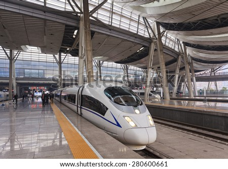 Beijing train station platform with boarding fast train for traveling people to quickly reach destination - stock photo