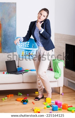 Being a businesswoman and young housekeeper, vertical - stock photo
