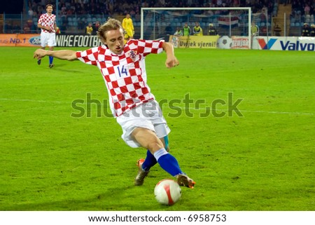 being a soccer player of FC Arsenal - Luka Modric - stock photo