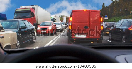 being inside passenger car within traffic jam in rush hour highway in city cars everywhere around - stock photo