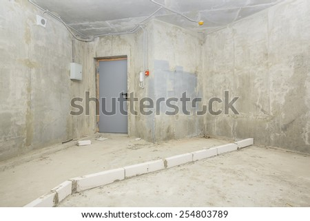 Being renovated house, apartment, entrance door, electrical shield, on-door speakerphone, fire alarm system - stock photo