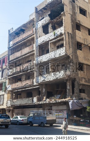 BEIRUT, LEBANON - JUNE 23, 2013 : Building in Haret Hreik area destroyed by Israeli bombing in the city of Beirut in 2006. Haret Hreik is the headquarters of the Shi'ite group Hezbollah - stock photo