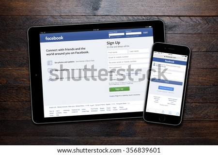 BEKASI, INDONESIA - DECEMBER 31, 2015: Facebook welcome page displayed on iPad and iPhone. The average Facebook U.S. user spends 40 minutes a day on the site. - stock photo