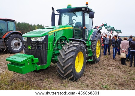 Belarus, Bobruisk district, September 9: The big green tractor on the field September 9, 2015 in Bobruisk district, Belarus.