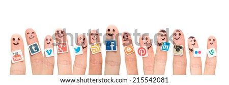 BELCHATOW, POLAND - AUGUST 31, 2014: Happy group of finger smileys with popular social media logos printed on paper and stuck to the fingers. - stock photo