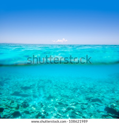 Belearic islands turquoise sea under over in out waterline tropical beach - stock photo