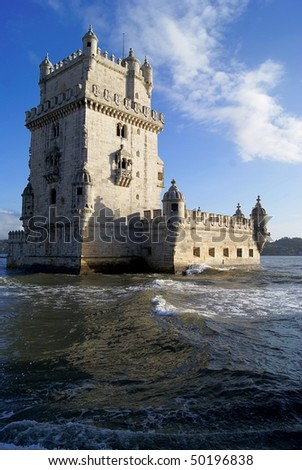 Belem Tower at sunset with waves in front. Photo taken on Lisbon, Portugal.