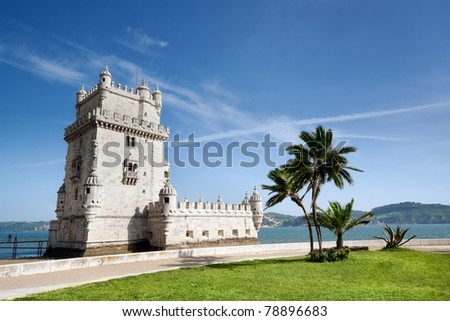 Belemsky turret on the river Tagus in Lisbon, Portugal, against palm trees - stock photo