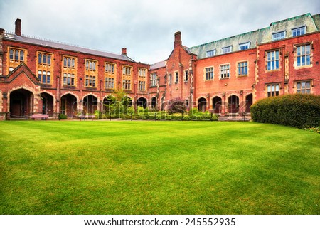 BELFAST, NORTHERN IRELAND - MAY 9, 2009: View at the Queen's University of Belfast in rainy moody day. Queen's Belfast University is the main educational institution in Northern Ireland - stock photo