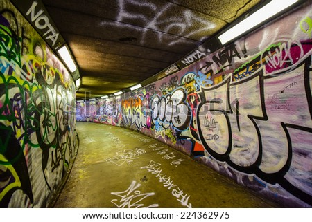 BELFAST, UK - SEP 27: Graffiti by unidentified artists in Belfast. Graffiti is writing or drawings that have been scratched,or sprayed illicitly on a wall or other surface, often in a public place. - stock photo