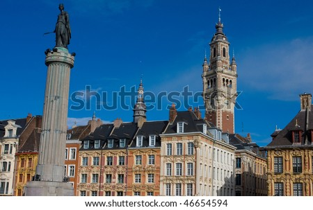 Belfry, historical houses and the statue and column of Deesse (made in 1845), the goddess and a symbol of the city Lille in France.