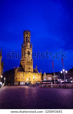 Belfry of Bruges and Grote Markt night view - stock photo