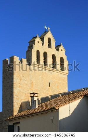 Belfry of fortified church of Saintes-Maries-de-la-mer, France - stock photo