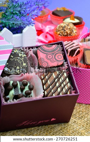 Belgian chocolate handmade chocolate candies in different shapes and colors on sacking background - stock photo