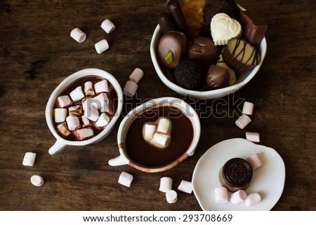 Belgian chocolate in a white bowl on a wooden table