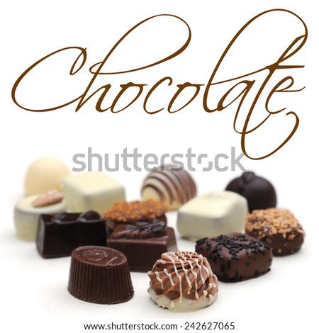 Belgian chocolates on white, shallow depth of field, selective focus, easy removable sample text - stock photo