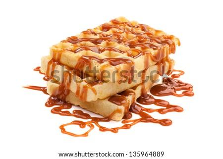 Belgian waffles under the caramel topping - stock photo