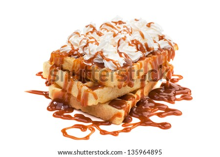 Belgian waffles under the caramel topping with cream on top - stock photo