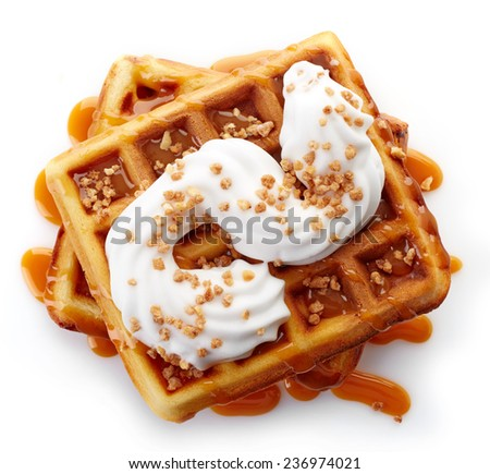 Belgian waffles with caramel sauce and whipped cream isolated on white background (top view) - stock photo