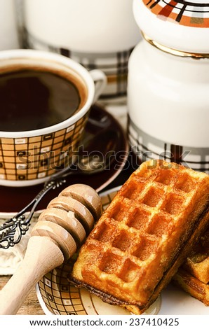 Belgian waffles with coffee and honey - stock photo